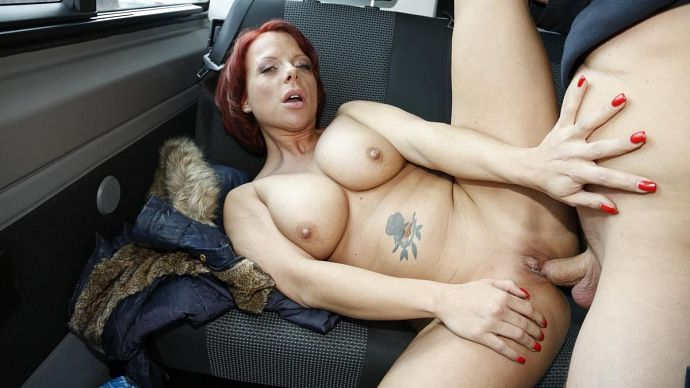 PornDoePremium_-_BumsBus_-_Jolyne_-_This_tattooed_German_redhead_is_down_for_a_blowjob_and_a_titjob_in_the_car_-_25.07.2016.jpg