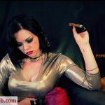 Young Goddess Kim in Celebratory Cigar