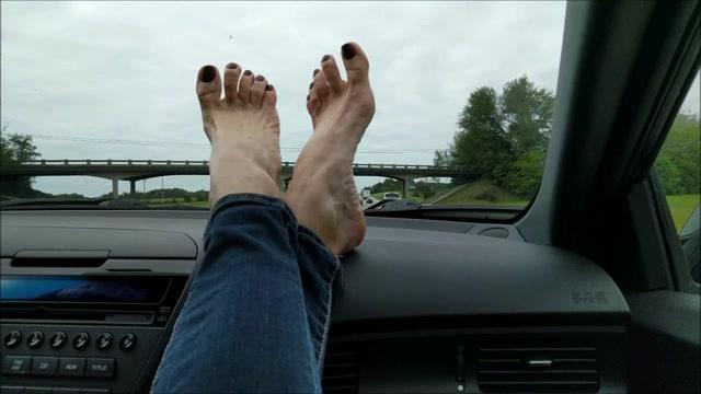 Mo_Rina_-_mature_feet_on_dashboard.mp4.00010.jpg