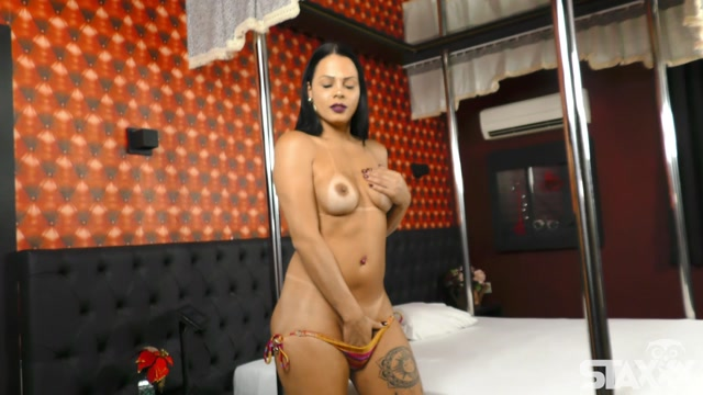 Tranny Candy presents Bruna Castro Hot brunette babe rubs her hard cock 00002