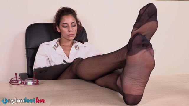 Hot secretary Mayla places her nyloned feet on the office desk 00013