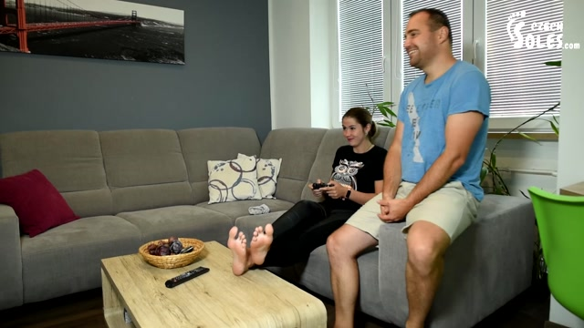 Czech Soles - College girl plays video games as her feet get worshiped 00001