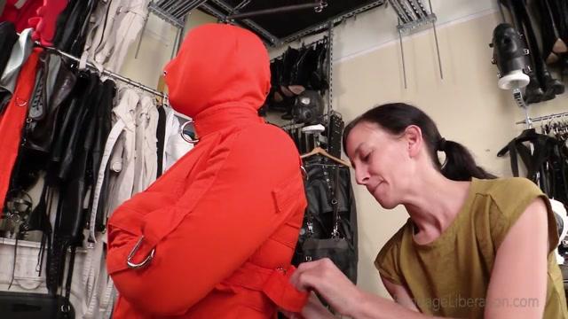 Elise Graves - Elise Restrains Bondage Slut Patrick in Orange Straitjacket 00003
